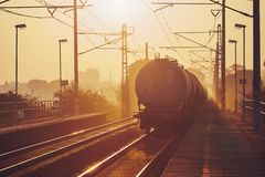 Freight train at sunrise royalty free stock photography