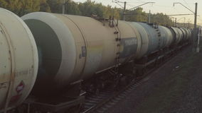 Freight train at sunset. View from the window of the suburban train, sunset stock video