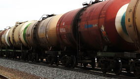 Freight train with tank cars passing by stock video