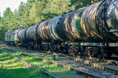 Freight train with tank wagons. Moving in forest stock photo