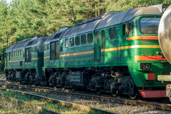 Freight train with tank wagons. Moving in forest royalty free stock photography