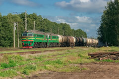Freight train with tank wagons. Moving in forest stock image