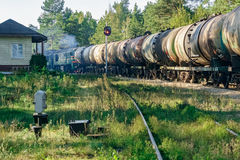 Freight train with tank wagons. Moving in forest Stock Photography