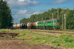 Freight train. With tank wagons moving in forest Stock Photography