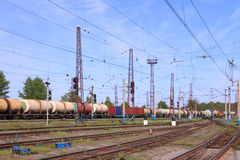 Freight train with tanks moves on rusty railway Stock Photo