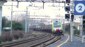 Freight Train Transit. Shoot in an Italian Station. Tanker car Transporter stock footage