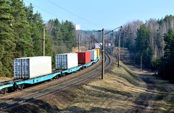 Freight train, transportation of railway cars by cargo containers shipping. Railway logistics concept royalty free stock photo