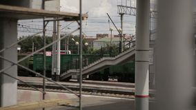Freight train travels through the train station stock video