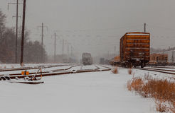 Freight train travels through the vast expanses of snow-covered Royalty Free Stock Image
