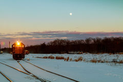 Freight train travels through the vast expanses of snow-covered Royalty Free Stock Photography