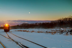 Freight train travels through the vast expanses of snow-covered. Winter snow railway wagons freight train travels through the vast expanses of snow-covered Royalty Free Stock Photography