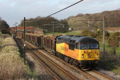 Freight train on West Coast mainline in Lancashire Royalty Free Stock Photo