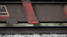 Freight train wheels. Freight train on track showing wheels and passing by stock video footage