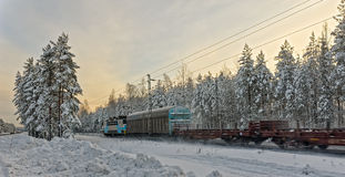 Freight train in winter landscape Stock Photography