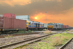 Freight trains on cargo terminal at dusk Stock Photography