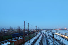Freight trains with carriages stand on railways Royalty Free Stock Photo
