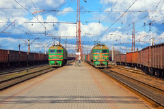 Freight trains passing station. Different freight trains passing railway station stock photos
