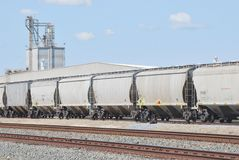 Freight trains and processing plant Royalty Free Stock Photo