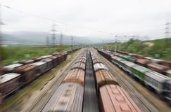 Freight trains in rail yard. Freight cars and trains in a rail yard.  Blurred focus Royalty Free Stock Photo
