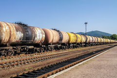 Freight trains.Railroad train of tanker cars transporting crude oil on the tracks Stock Image