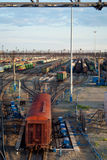 Freight Trains and Railways on big railway station. City landscapes Stock Photos