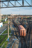 Freight Trains and Railways on big railway station. City landscapes Royalty Free Stock Images