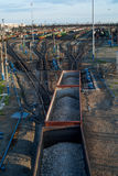 Freight Trains and Railways on big railway station. City landscapes Royalty Free Stock Image