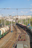 Freight trains at railways and many wires Stock Image