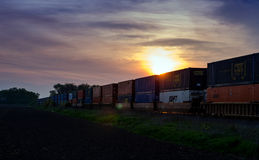 Freight trains at sunset Royalty Free Stock Photo