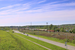 Freight trains with tanks stand on railway station Stock Image