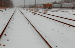 Freight trains under snow on winter cargo terminal Royalty Free Stock Photography