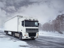 Freight transportation by truck. Winter freight transportation by truck Royalty Free Stock Photos