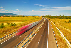 Freight Truck in Motion on Highway Stock Image