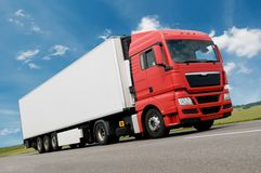 Freight truck on road. Red white Long vihicle truck in motion on road stock photo