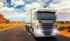 Freight truck on road in valley, front view royalty free stock image