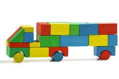 Freight truck toy blocks, multicolor car wooden transportation. Cargo delivery, isolated white background Stock Photos