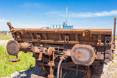Freight wagon rail. Railway freight wagon, with a factory in the background Stock Photography