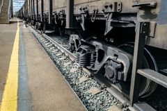Freight wagons with cargo on rails near the platform. Horizontally. View from above.Freight wagons awaiting departure at the station Stock Images