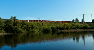 Freight wagons. Over the pond Stock Photos