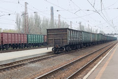 Freight wagons are standing in line at the railway station Stock Photo