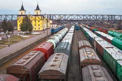 Freight wagons at the station. Rail transportation. Freight. A train carrying wood, timber. Trade blockade stock photo