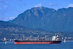 Freighter in Burrard Inlet from the Pacific Ocean Royalty Free Stock Photos
