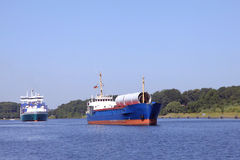 Freighter and feeder ship on Kiel Canal Stock Image