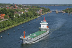 Freighter near the ship lock of Kiel Holtenau Royalty Free Stock Photo