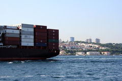 Freighter over Bosphorus. Freighter passing over Bosphorus, Istanbul, Turkey Royalty Free Stock Photo