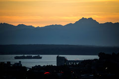 Freighter on Puget Sound. With Orange Sunset Royalty Free Stock Images