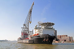 Freighter in Rotterdam harbor in the Netherlands Royalty Free Stock Photo