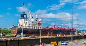 Freighter ship passes through Panama Canal. Panama Canal, Panama, Dec 5, 2017 - Freighter ship passes through Panama Canal Royalty Free Stock Photos