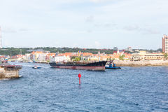 Freighter Towed Past Red Channel Marker Stock Image