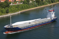 Freighter with wind power rotors on board Stock Image